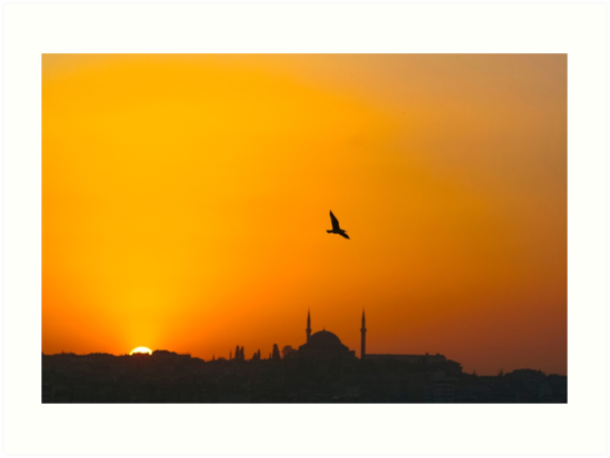 Sunset over Istanbul, Turky as seen from the Bosphorus. A mosque can be seen in the centre  by PhotoStock-Isra