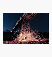 Fire spinning under bridge Photographic Print