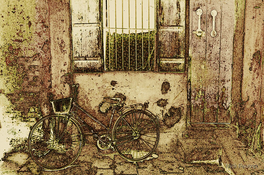 Bike against the wall by Nick Pautrat