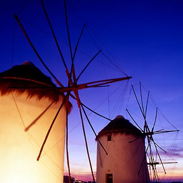 Greece. Mykonos Town. Illuminated windmills at dusk. by SPOutram
