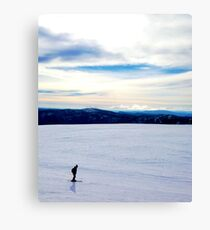 Skiing Across the Snow Covered Plateau Landscape Canvas Print