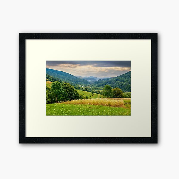 village on hillside meadow Framed Art Print