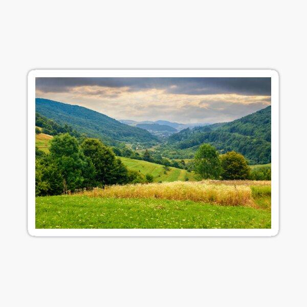 village on hillside meadow Sticker