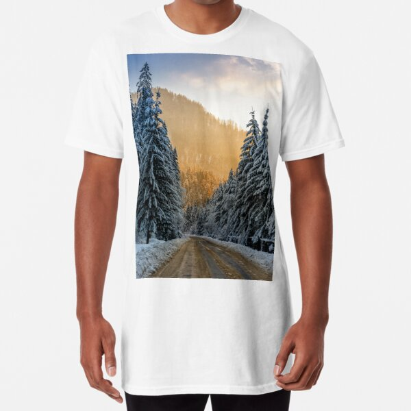 snowy road through spruce forest at sunset Long T-Shirt