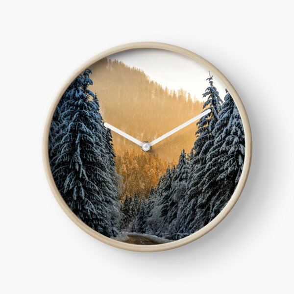 snowy road through spruce forest at sunset Clock