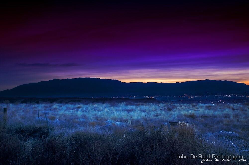 Sunrise Over The Sandia Range by John  De Bord Photography