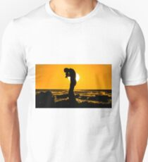 Silhouette of a photographer taking pictures on a beach at sunset Unisex T-Shirt