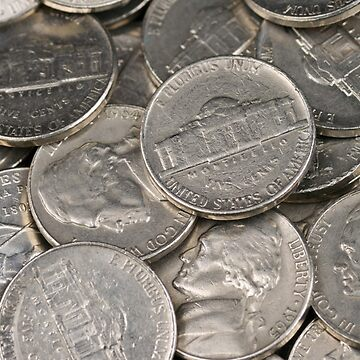 A close up image of American nickels by tethysimaging