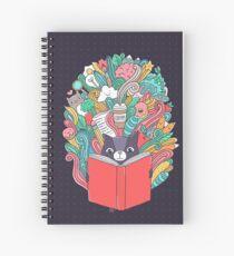 Cat reading a book. Spiral Notebook