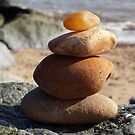 Stack of pebbles at the beach by Jax Blunt