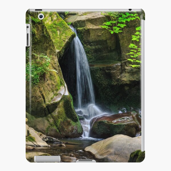 waterfall comes out of a huge stone in forest iPad Snap Case