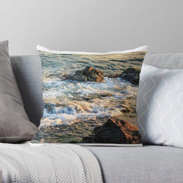 wave rolls onto the rocky coast Throw Pillow