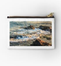 wave rolls onto the rocky coast Studio Pouch
