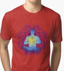 man sitting in the lotus position doing yoga meditation Tri-blend T-Shirt