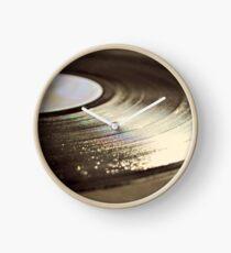 Old vinyl record. Clock