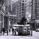 Newspaper Stand on the Gran Via - B&W by Tom Gomez