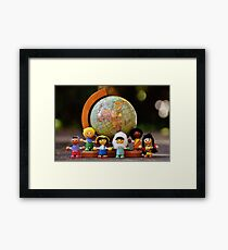 small world puppets Framed Print