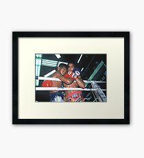 fighters embrace Framed Print