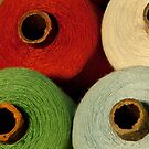 colorful tailor thread on bobbins by mrivserg