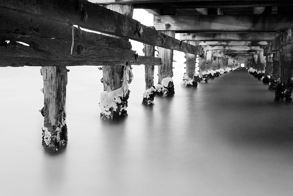 A light at the end of the pier by Antoni Alonso