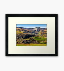 Rail road winds through mountainous rural area Framed Print