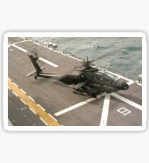 Aircrew of an AH-64 Apache helicopter conducting preflight checks before lifting off from the USS Nassau. Sticker
