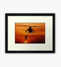 Four AH-64 Apache anti-armor helicopters fly in formation at dusk. Framed Art Print
