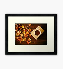 Cup of tea, books and autumnal foliage Framed Print