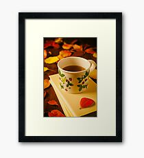 Cup of tea, books and colorful autumnal foliage Framed Print