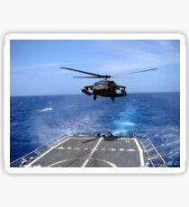 An Army UH-60 Black Hawk helicopter landing aboard the USS Underwood off the coast of Honduras. Sticker
