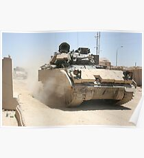 An M2 Bradley Fighting Vehicle patrols past Command Post Hit, Iraq. Poster