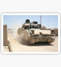 An M2 Bradley Fighting Vehicle patrols past Command Post Hit, Iraq. Sticker