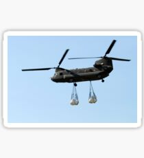 A CH-47 Chinook carrying sandbags. Sticker