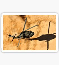 A UH-60 Black Hawk helicopter comes in for a dust landing. Sticker