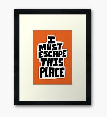 I must escape this place Framed Print