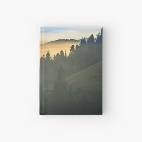 pine forest in fog at sunrise Hardcover Journal