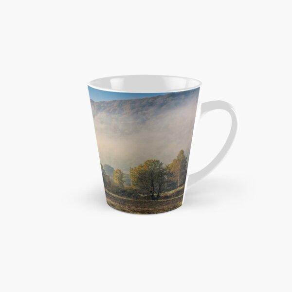 morning fog among trees Tall Mug