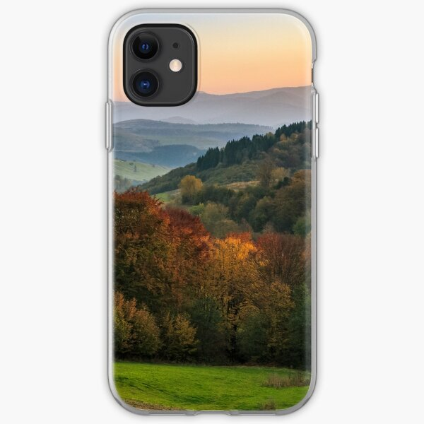 sunset over autumn forest in hazy mountains iPhone Soft Case