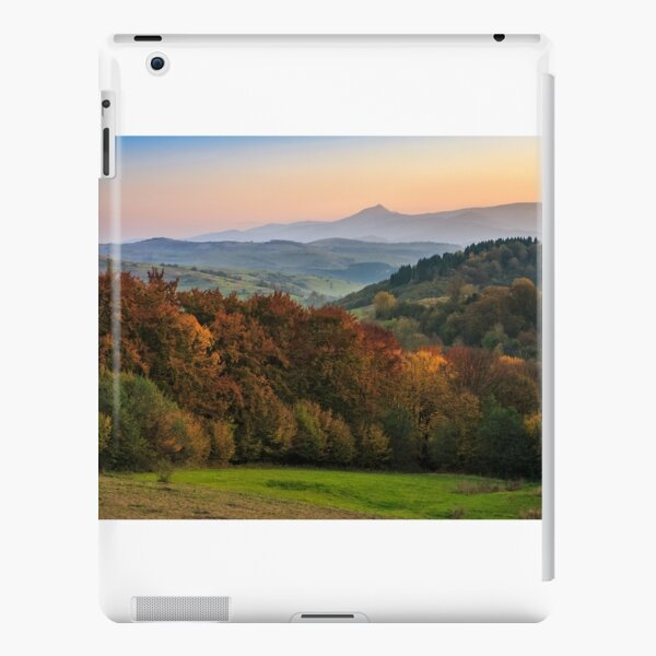 sunset over autumn forest in hazy mountains iPad Snap Case