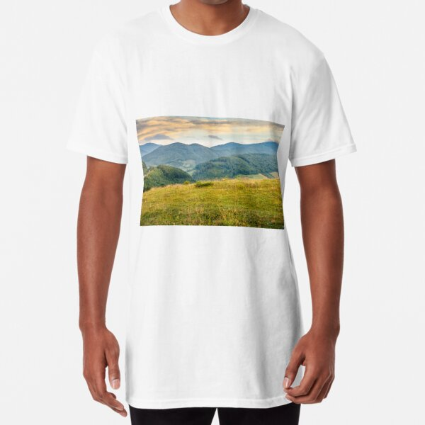 grassy meadow in mountains at sunrise Long T-Shirt