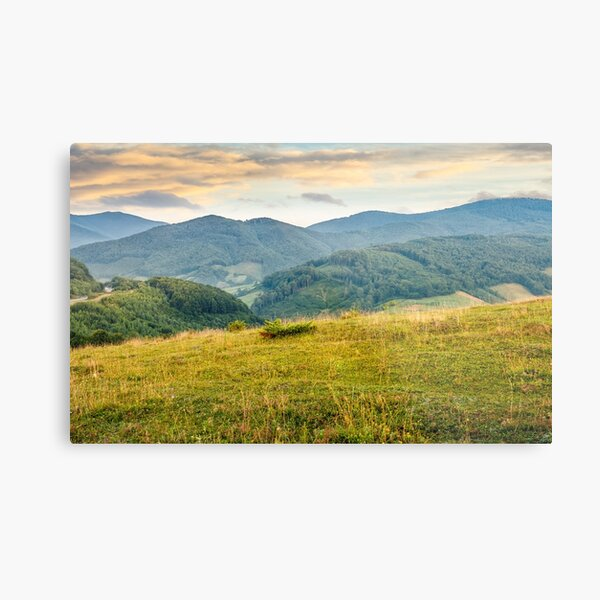 grassy meadow in mountains at sunrise Metal Print