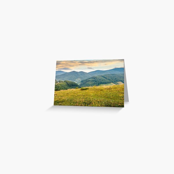 grassy meadow in mountains at sunrise Greeting Card