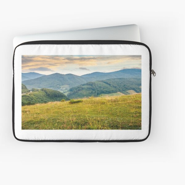 grassy meadow in mountains at sunrise Laptop Sleeve