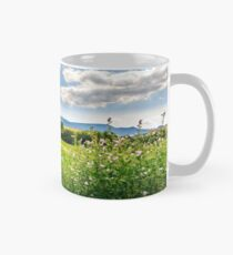 countryside summer landscape with field, forest and mountain ridge Mug