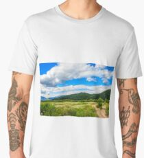 countryside summer landscape with field, forest and mountain ridge Men's Premium T-Shirt