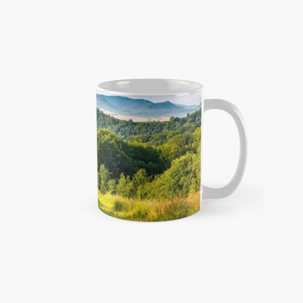 stacks of hay on the hill side Classic Mug