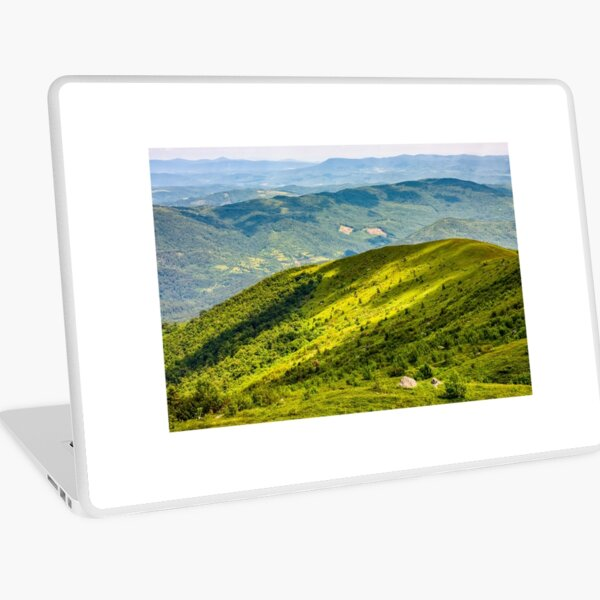 grassy hillside on mountain in summer Laptop Skin