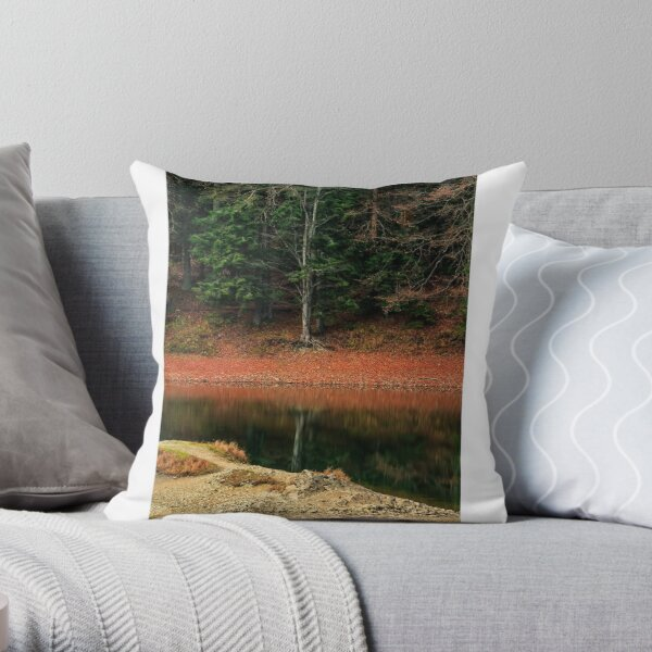 spruce forest on the lake in mountains Throw Pillow