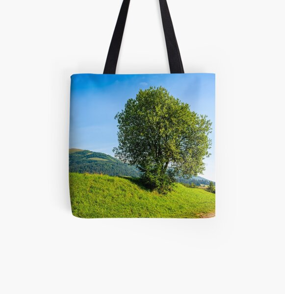 tree in rural area on beautiful summer day All Over Print Tote Bag