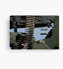 Expended brass falls from a machine gun. Canvas Print
